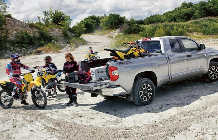 SILVER 2021 TOYOTA TUNDRA WITH DIRTBIKES BY TAILGATE