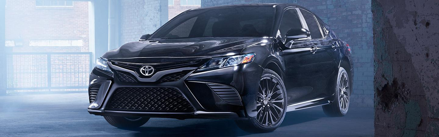 Black Toyota Camry driver profile view