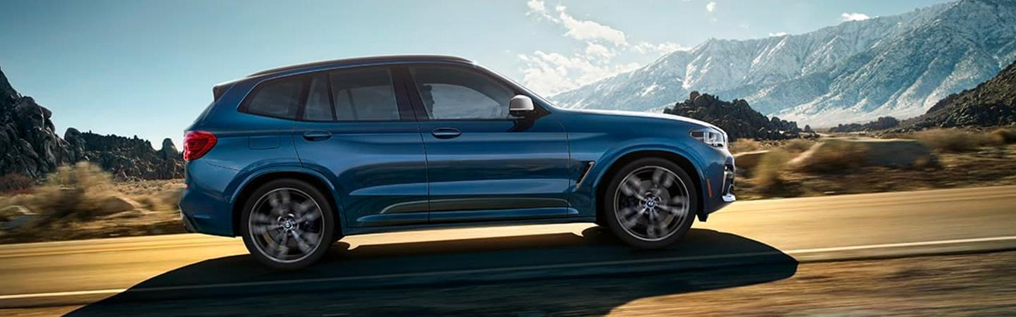 Blue 2020 BMW X3 in motion