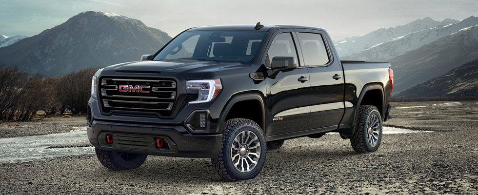 2019 GMC Sierra 1500 front view parked in mountains.