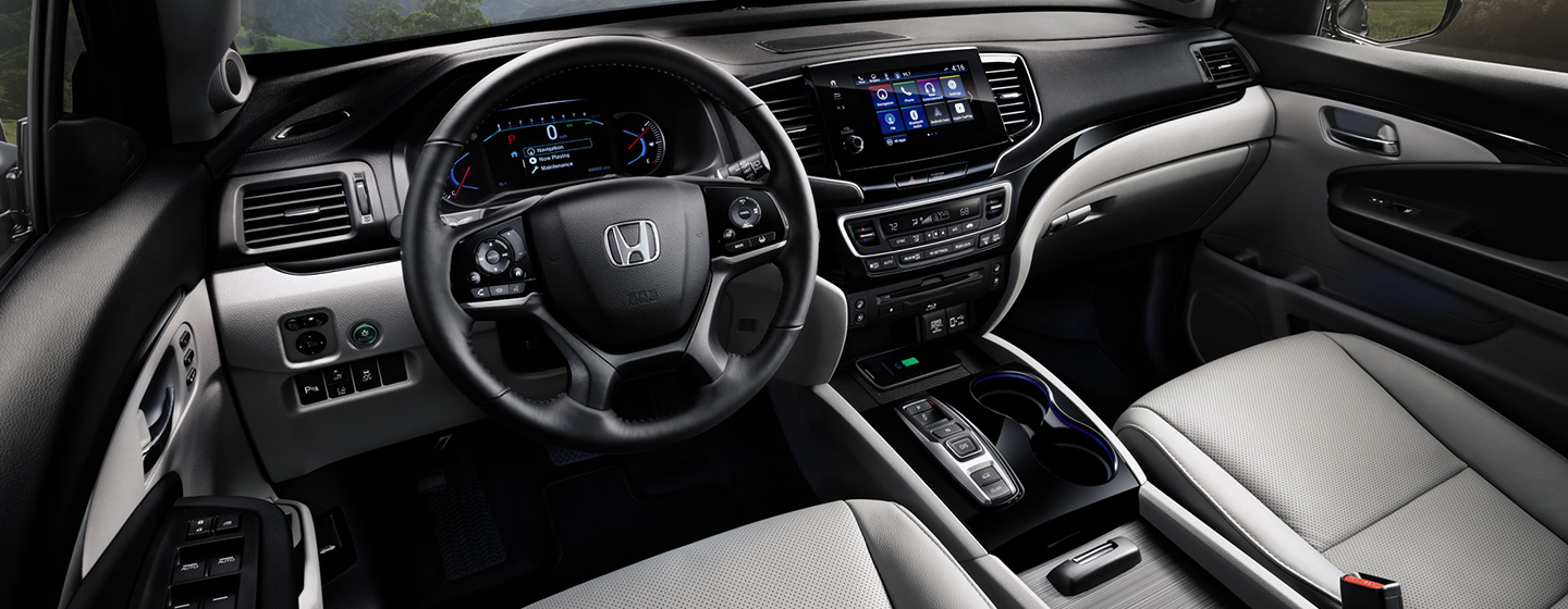 Safety features and interior of the 2019 Honda Pilot- available at our Honda dealership near Fort Myers, FL.