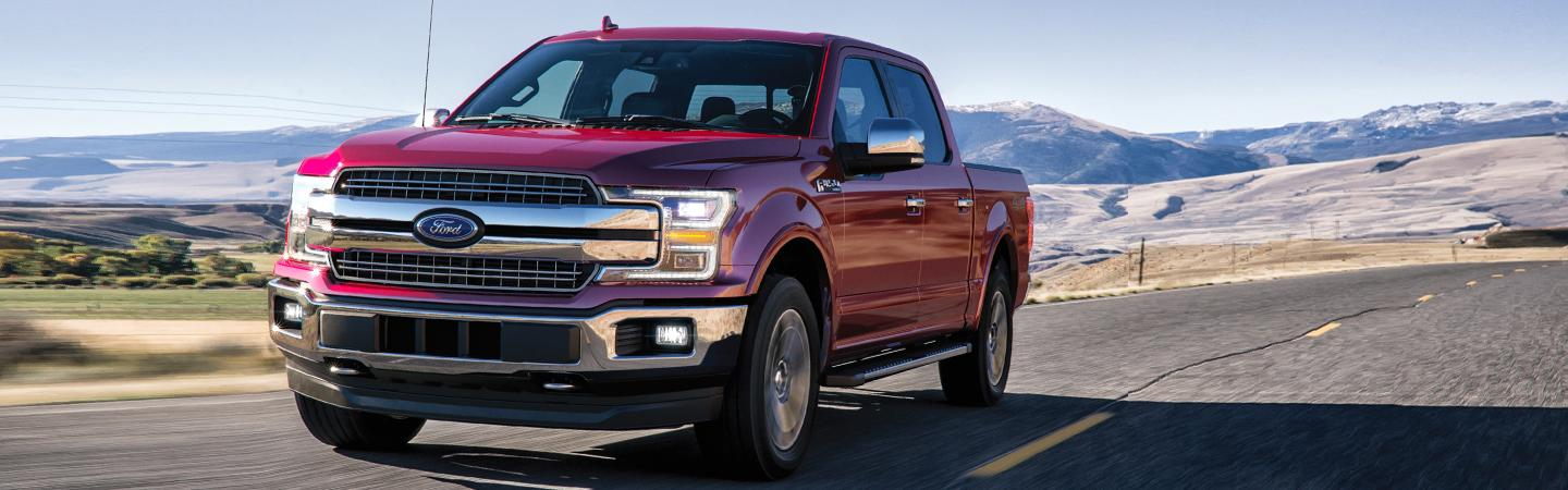 Front view of a red 2020 Ford F-150 in motion