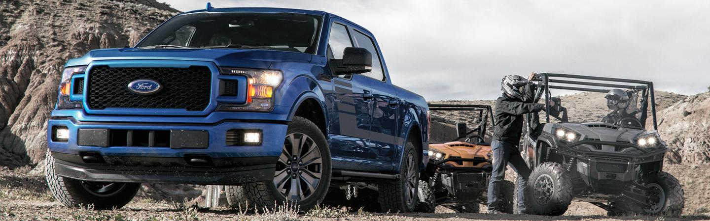 Front view of a blue 2020 Ford F-150 off roading