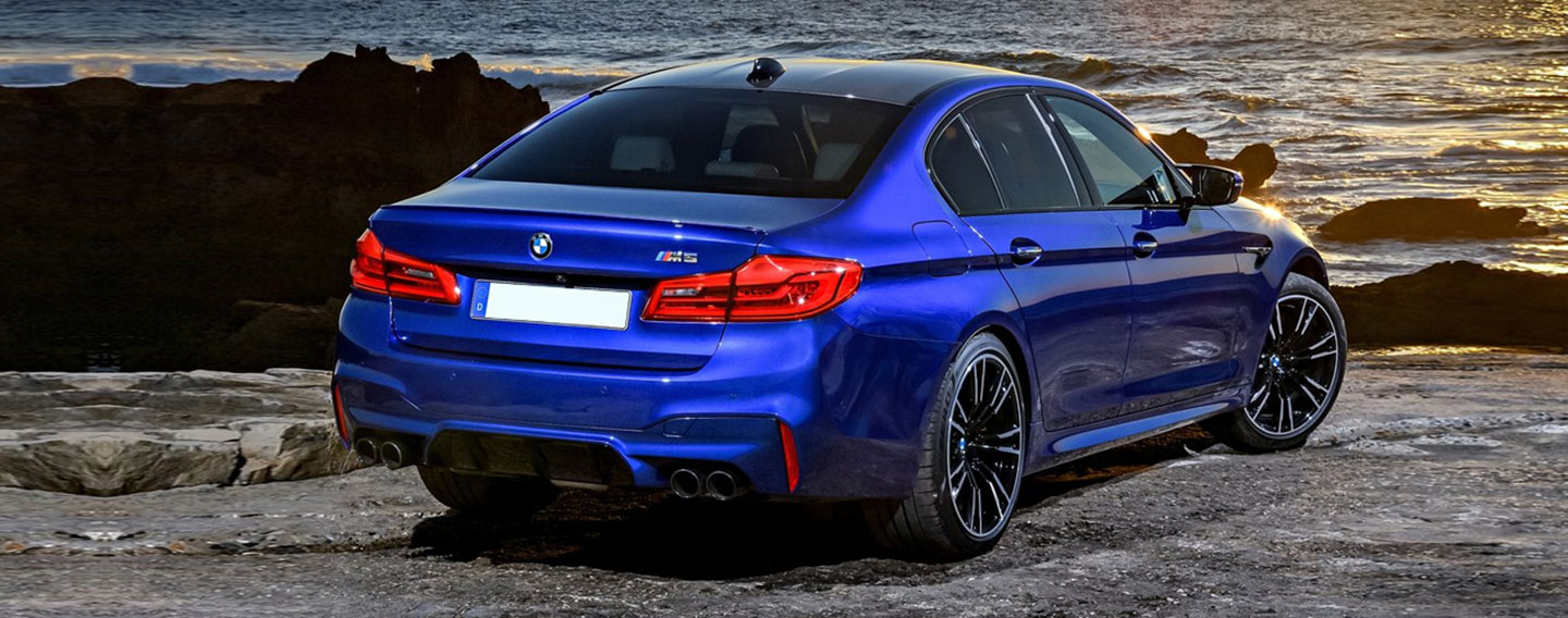Back Right of BMW M5 near the ocean