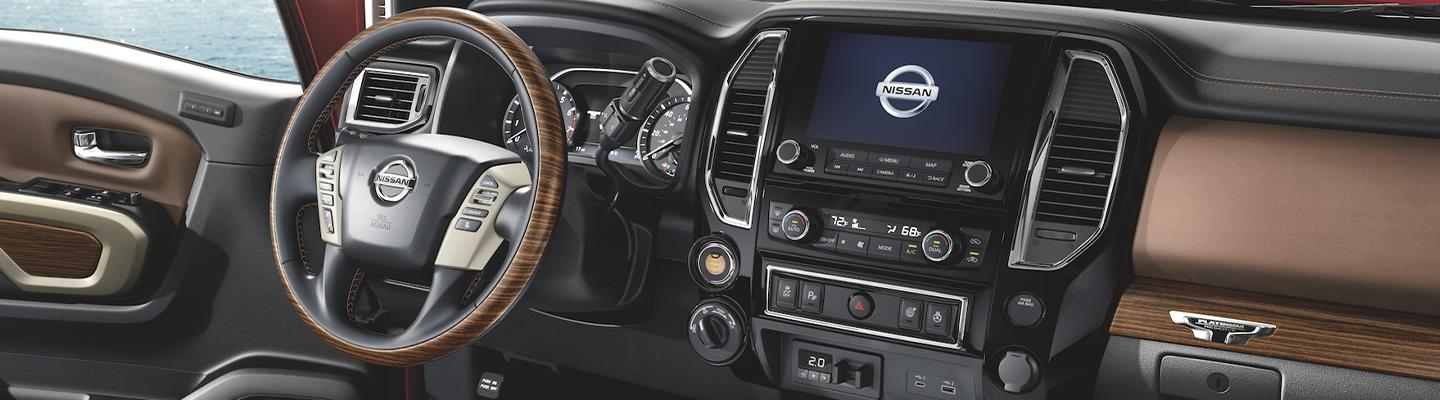 steering wheel and entertainment center of the 2020 Nissan Titan