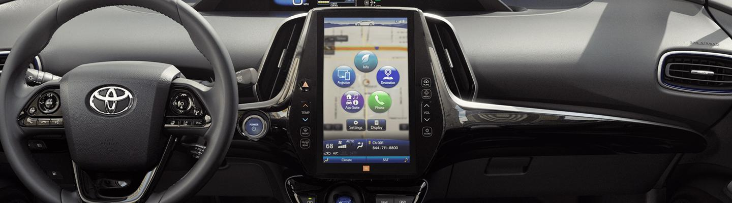 Upclose view of Toyota Dashboard technology with smart phone displaying apple car play