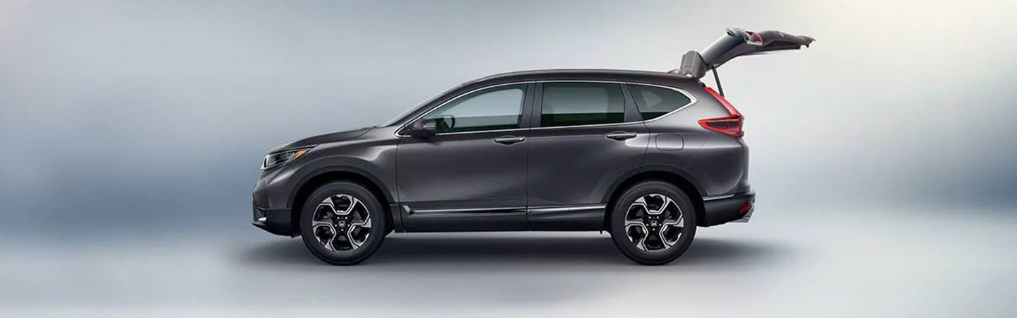 Side view of the 2019 Honda CR-V with trunk opened