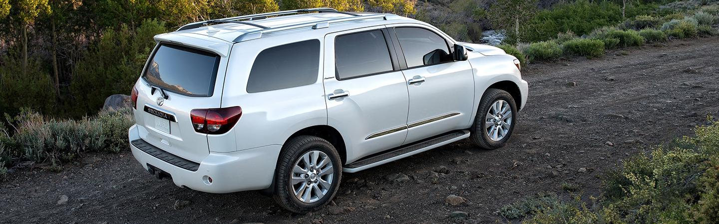 Aerial view of a white 2020 Toyota Sequoia driving off-road