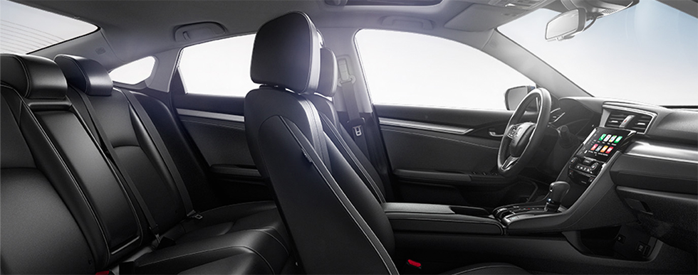 Safety features and interior of the 2018 Honda Civic - available at our Honda dealership near Gainesville, FL.
