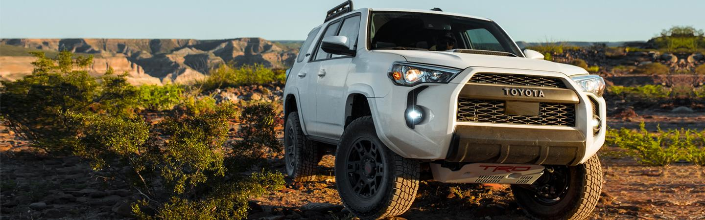 White 2020 Toyota 4Runner driving on a dirt road