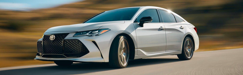 White 2020 Toyota Avalon in motion