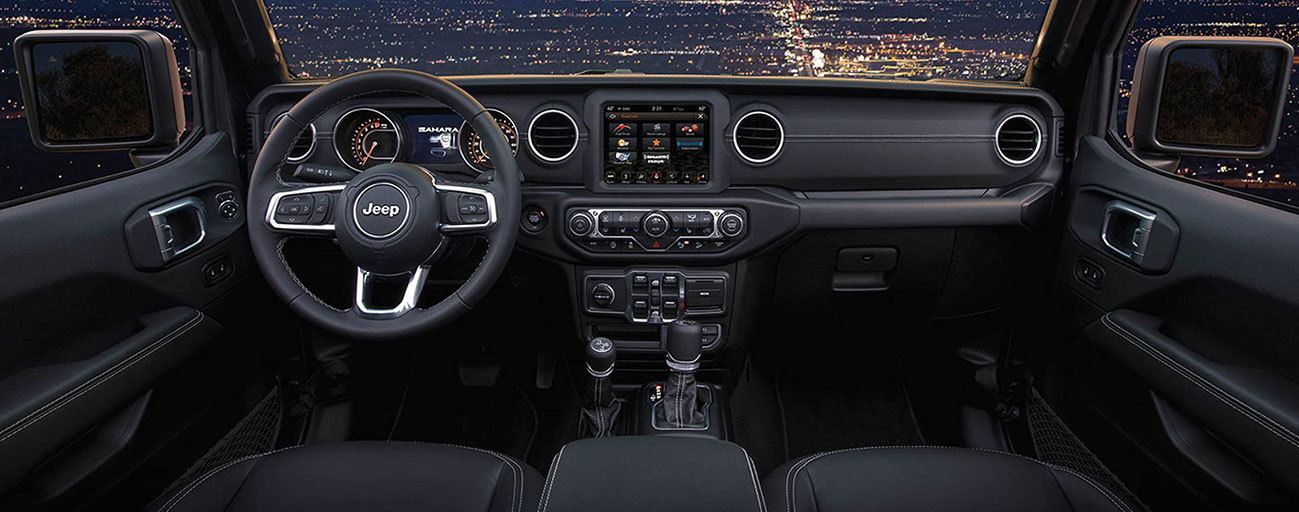 Safety features and interior of the 2019 Jeep Wrangler for sale at our Jeep dealership in Lake city.