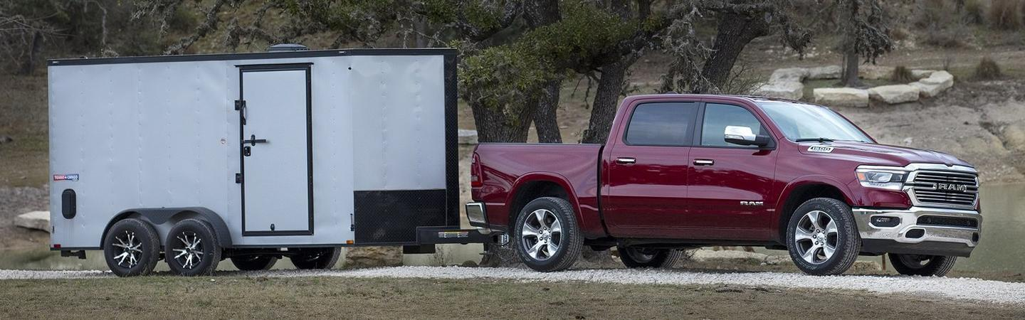 Side view of the 2020 RAM 1500 towing something in motion