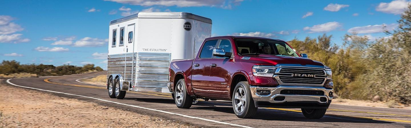 Front view of the 2020 RAM 1500 towing something in motion