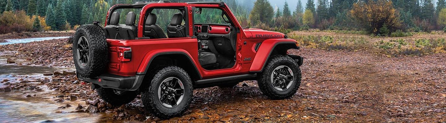 Side view of the 2020 Jeep Wrangler parked outside