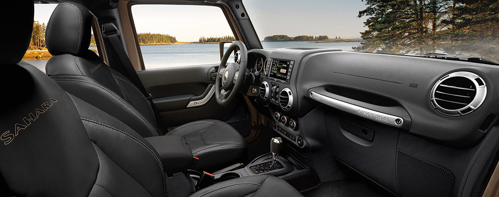 Safety features and interior of the 2018 Jeep Wrangler - available at our Jeep dealership near Naples, FL.