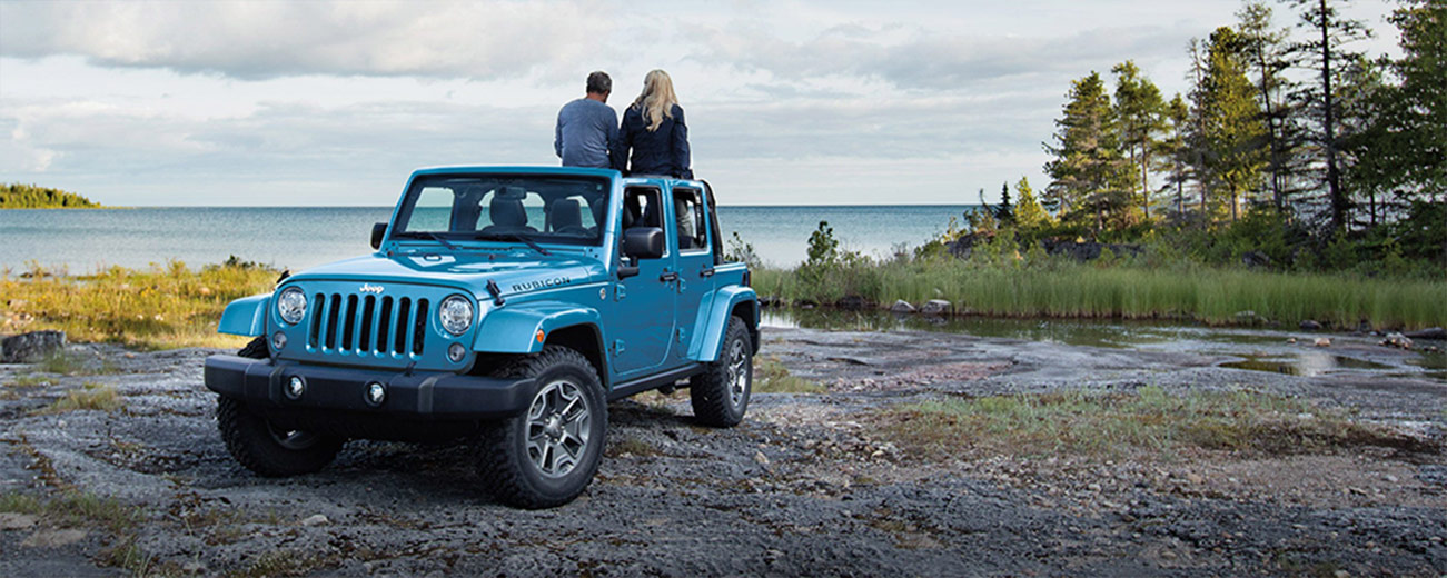 Exterior of the 2018 Jeep Wrangler parked next to a lake, available at Naples CDJR near Cape Coral, FL