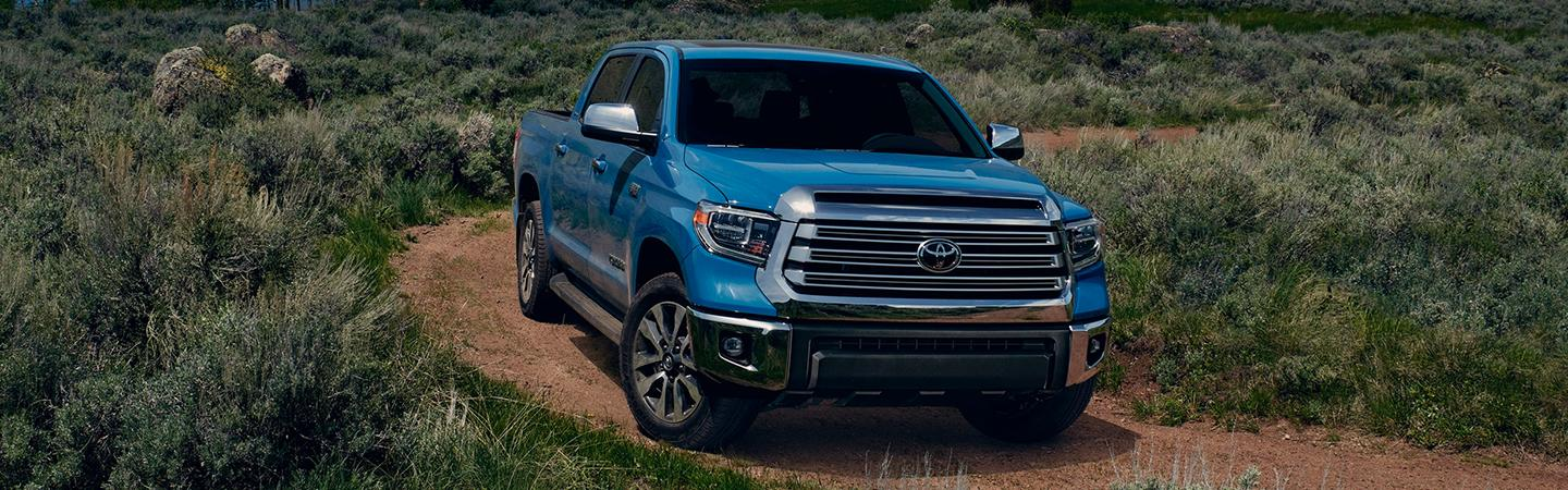 Blue 2020 Toyota Tundra driving off-road
