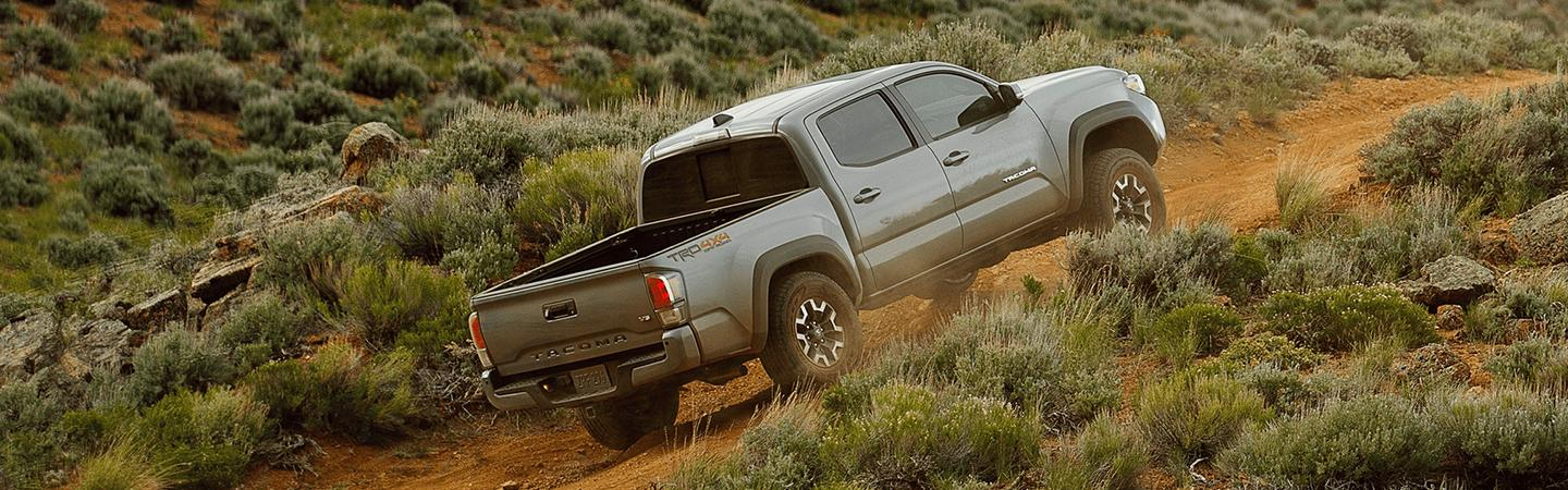 Toyota Tacoma driving up a hill