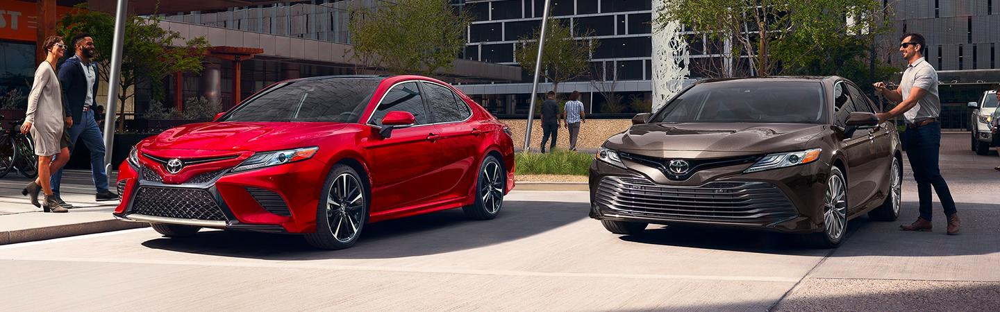 Two 2020 Toyota Camry's parked next to each other