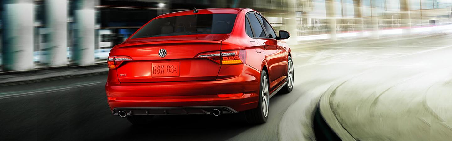 Rear view of the 2019 Volkswagen GLI driving in a turn