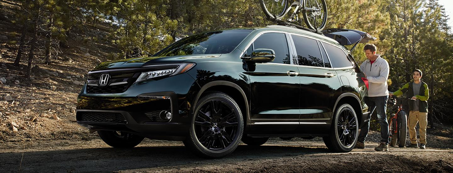 Front under view of the 2020 Honda Pilot parked with bikes attached