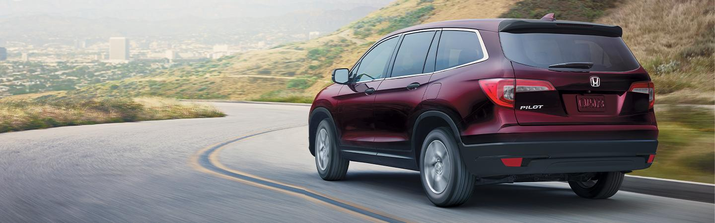 Side view of behind the 2020 Honda Pilot in motion