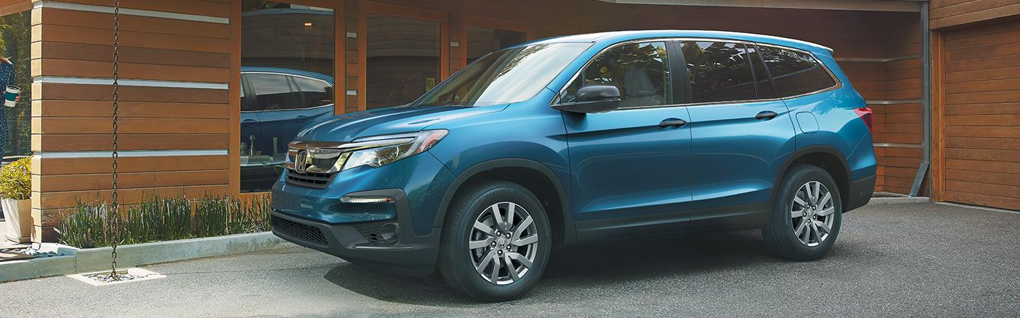 The 2020 Honda Pilot parked in a drive way