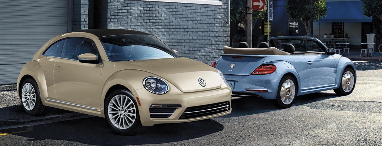 Two Volkswagen Beetle parked