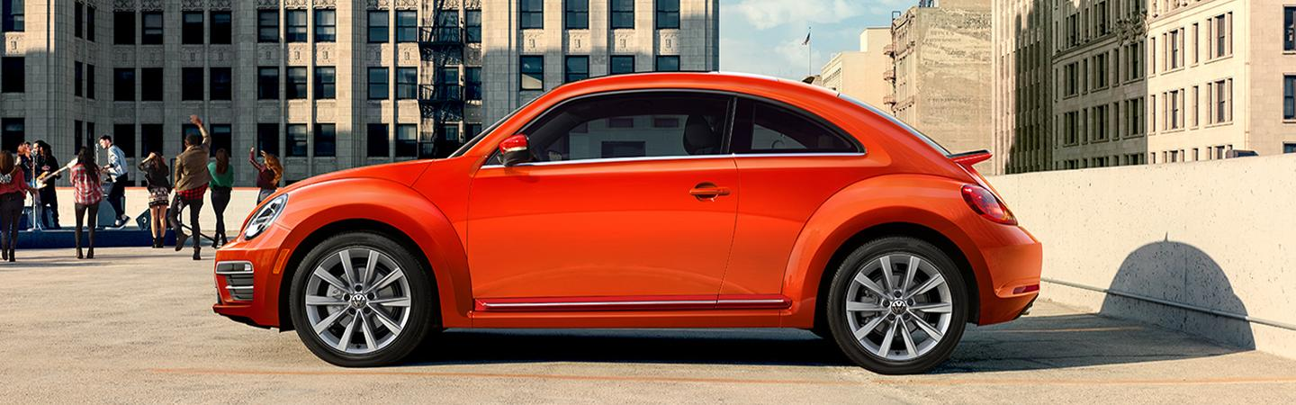 Orange side profile view of the Volkswagen Beetle