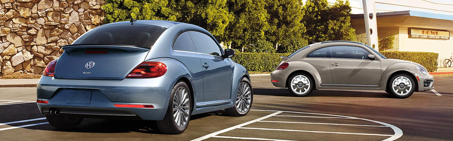 Two Volkswagen Beetle parked