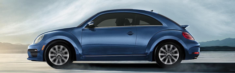Blue Volkswagen beetle in motion