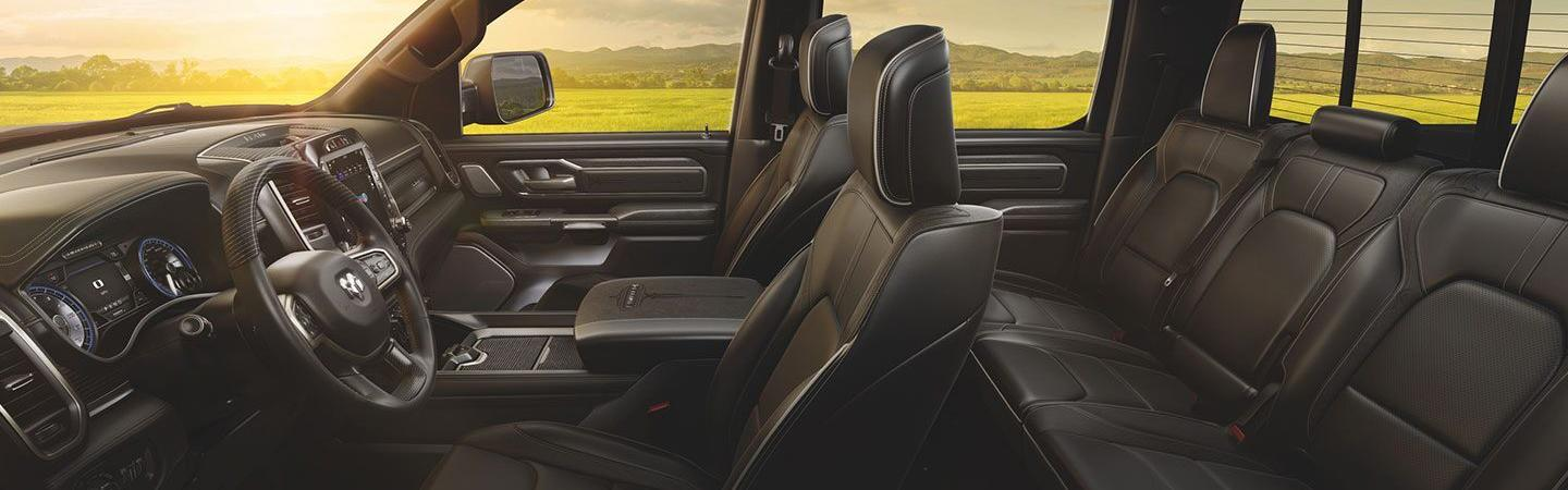 Inside of the 2020 RAM 1500's drivers side seat and steering wheel