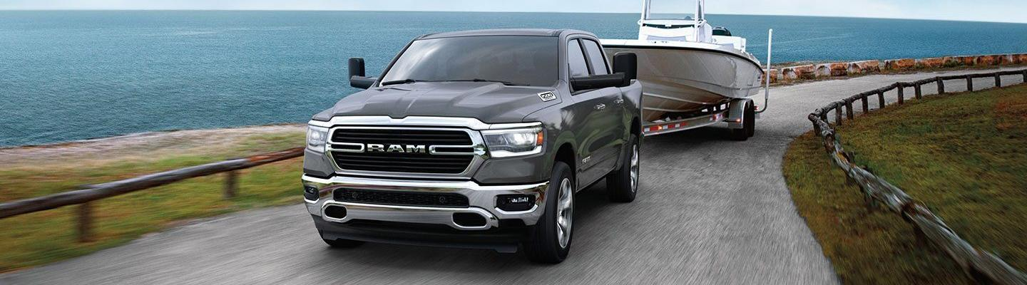 Front view of the 2020 RAM 1500 in motion towing something