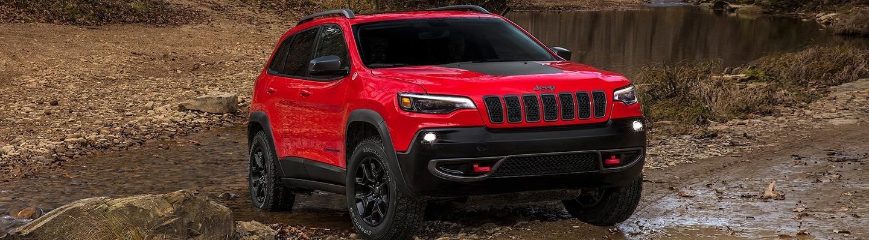 2021 Jeep Cherokee parked in muddy terrain