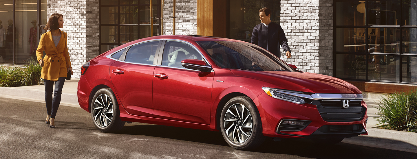 Side view of a red 2020 Honda Insight