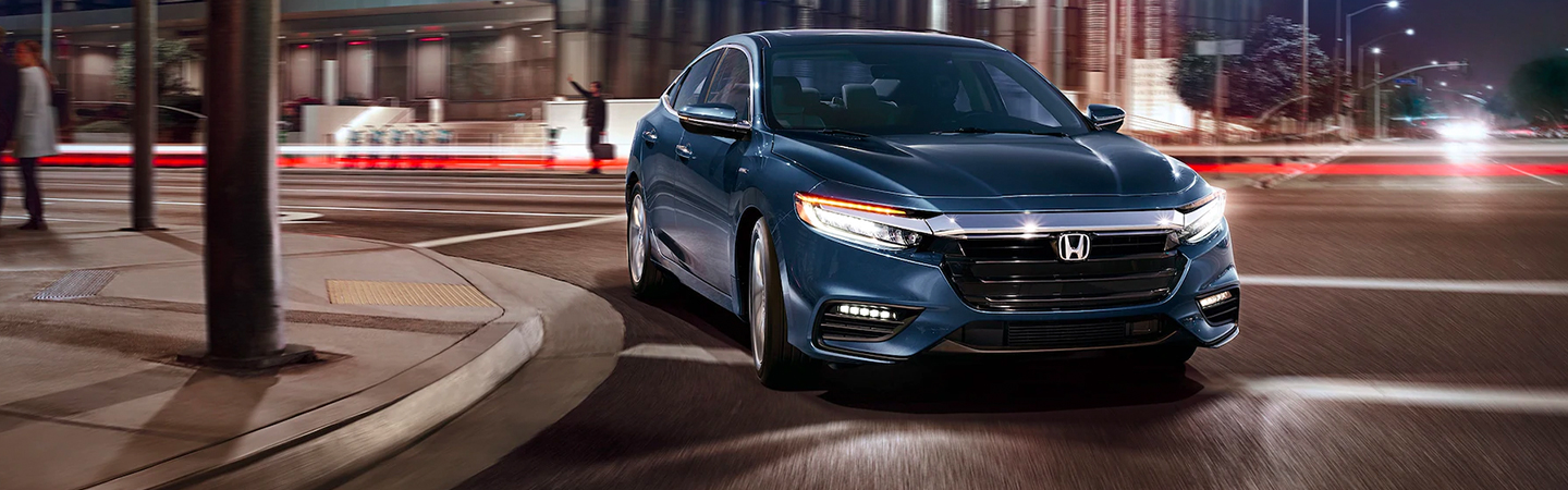 Front view of a 2021 Honda Insight in motion