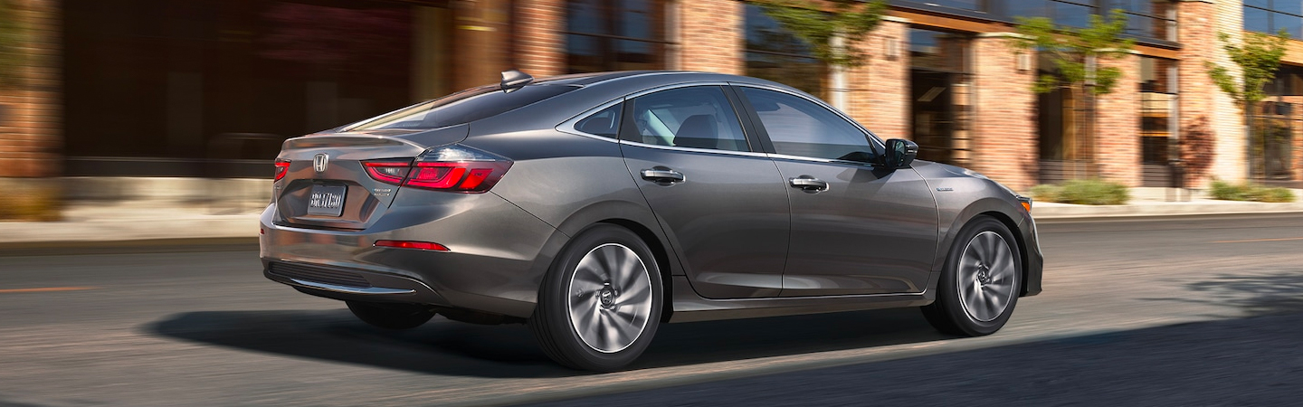 Side view of a 2021 Honda Insight in motion