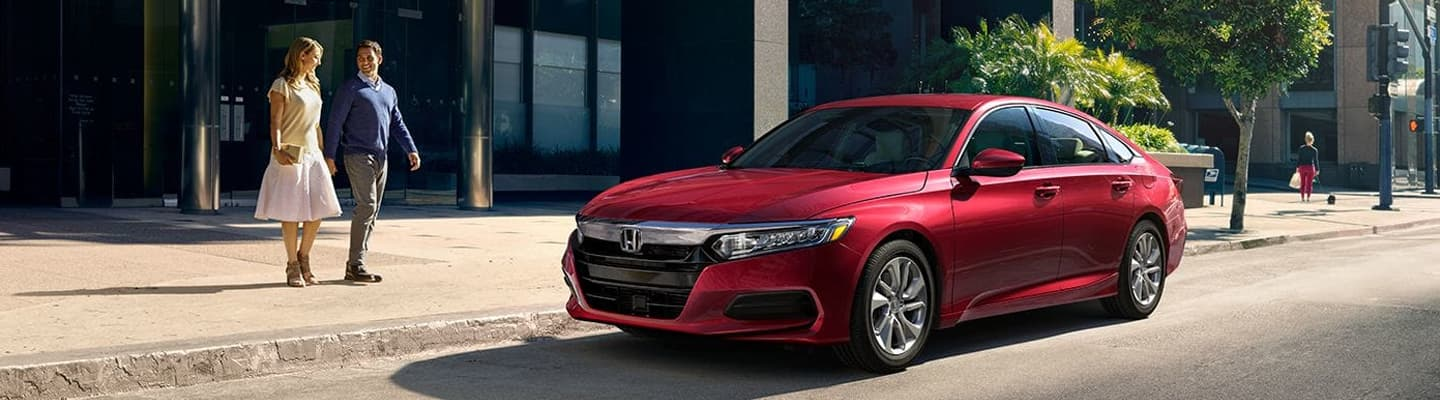 Couple walking to their parked 2019 Honda Accord