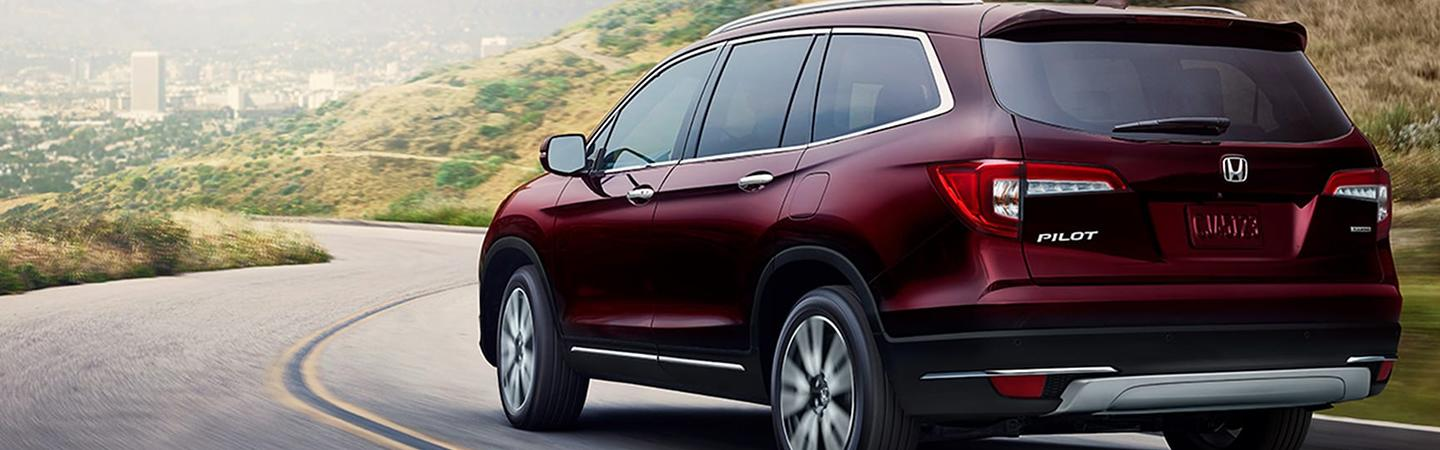 Side view of a red 2021 Honda Pilot