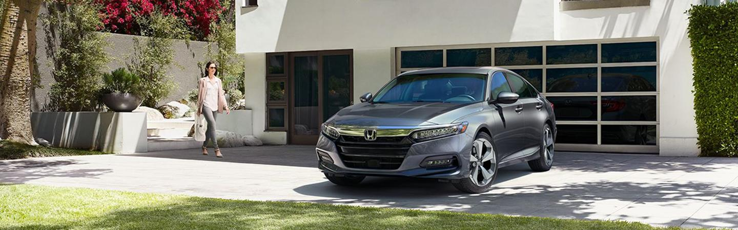 2020 Honda Accord parked in front of a driveway