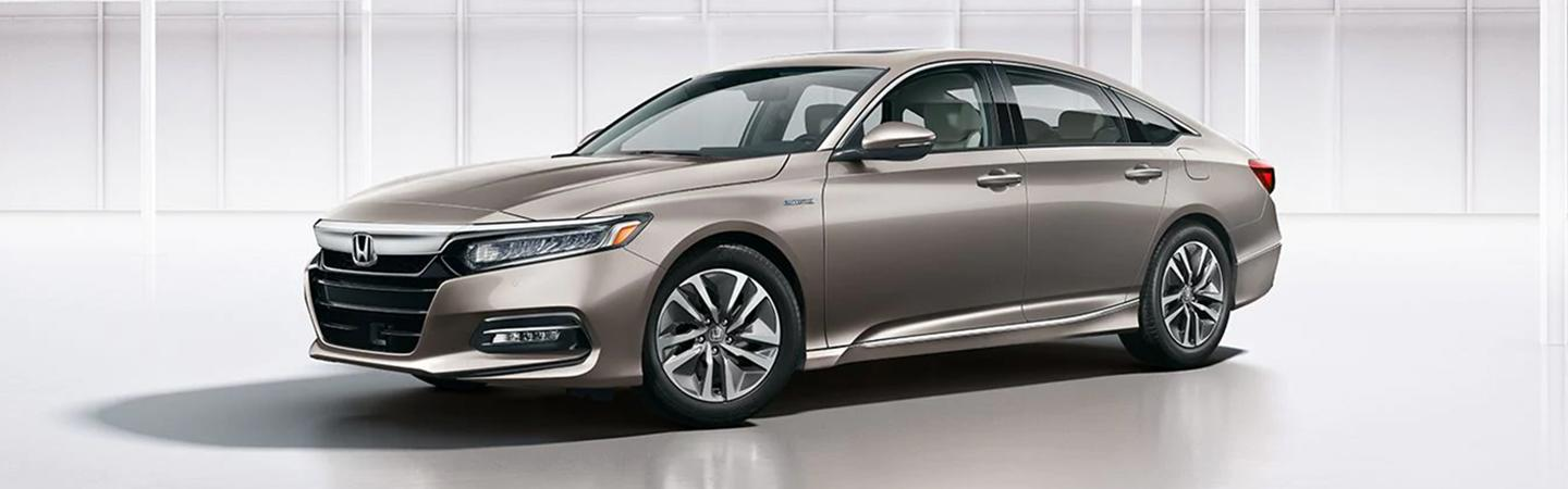 Side view of the 2020 Honda Accord parked inside
