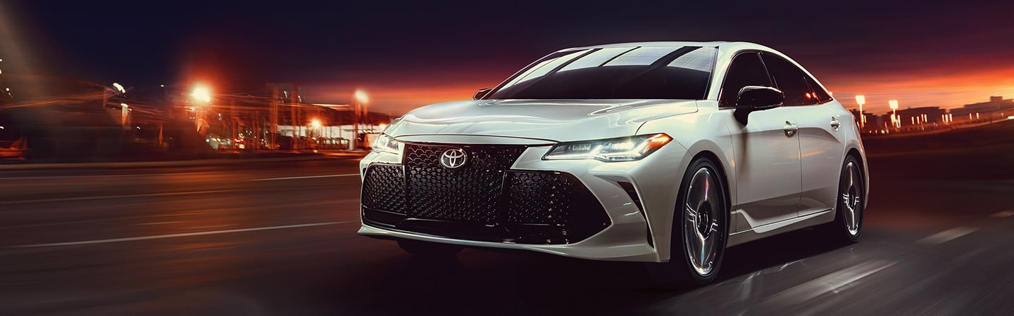 White 2020 Toyota Avalon driving