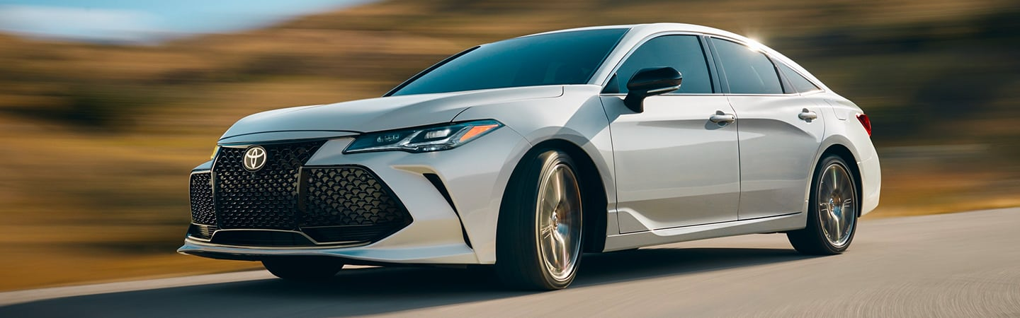 White 2020 Toyota Avalon in motion