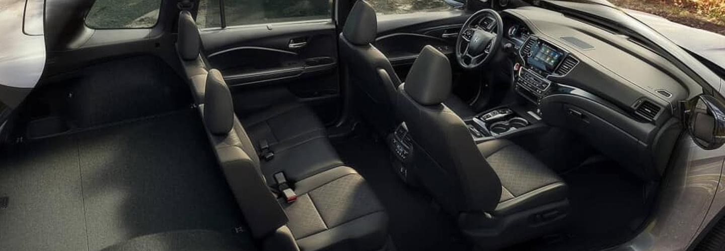 Overview of the interior seats and entertainment center of the 2021 Honda Passport
