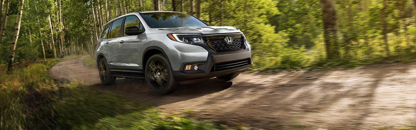 Side view of the 2021 Honda Passport in the woods