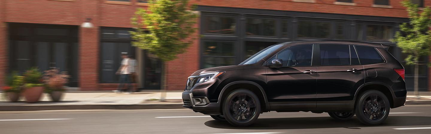 Side view of the 2021 Honda Passport in motion