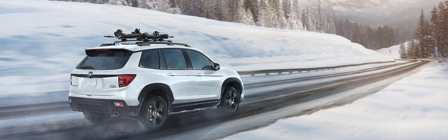 Side view of the 2021 Honda Passport in the snow