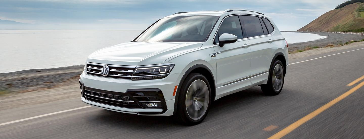 White 2020 Volkswagen Tiguan Driving next to the water