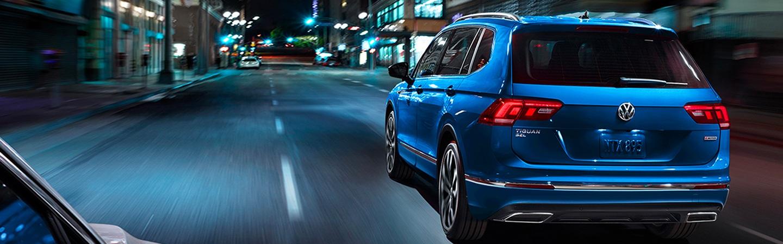 Blue 2020 Volkswagen Tiguan driving - Rear